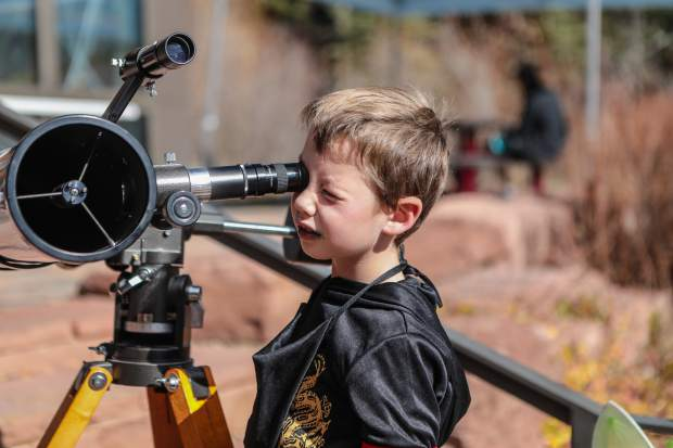 William Geoger of Gypsum checks out the telescope at the Walking Mountains Science Center Fright at the Museum Saturday, Oct. 27, in Avon. Different telescopes include one to look directly at the sun with a special lens.