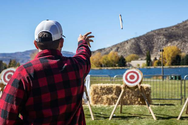 David Thompson of Aurora practices throwing hatchets before the second round starts at the Man of the Cliff competition, Saturday.