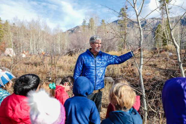 Seattle, Wash., artist John Fleming explains to Red Sandstone Elementary School third-graders his inspiration for his artwork based off aspen trees Friday, Oct. 26, at Maloit Park in Minturn. He was one of 77 artists selected to commission artwork for the Red Sandstone garage in Vail.