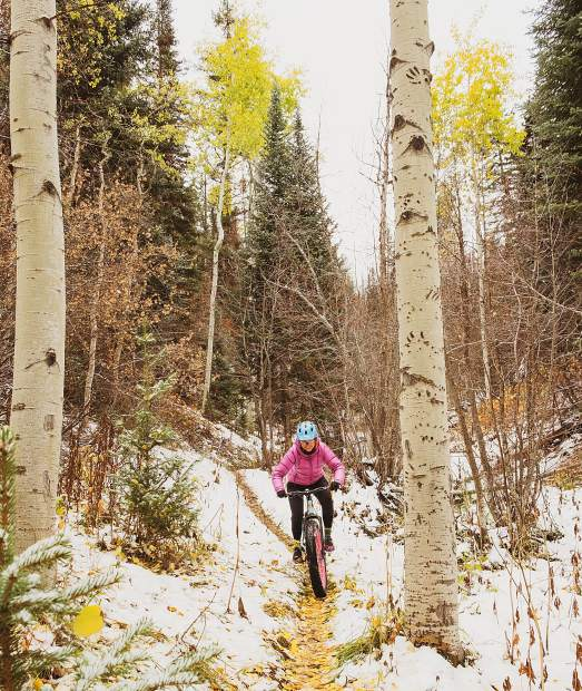 Ann Driggers fat bikes Oct. 13 on the Ditch Trail on Basalt Mountain. The trail suffered minimal damage, she reported. The trails and roads are re-opened to non-motorized traffic, but there is a danger of tree falling after they were damaged in the fire.