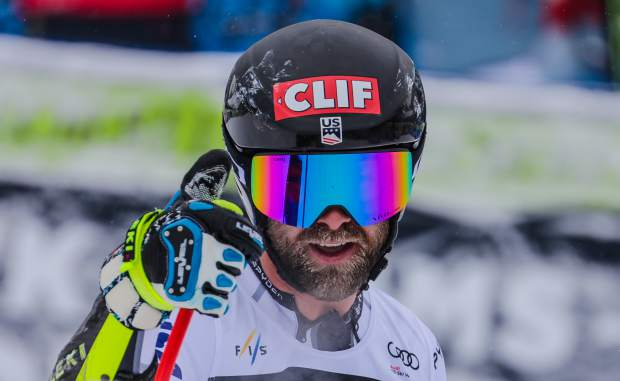 Travis Ganong, of the U.S., gives the crowd a thumbs-up after finishing the Xfinity Birds of Prey World Cup super-G race in 15th place. Ganong was the top placing American.