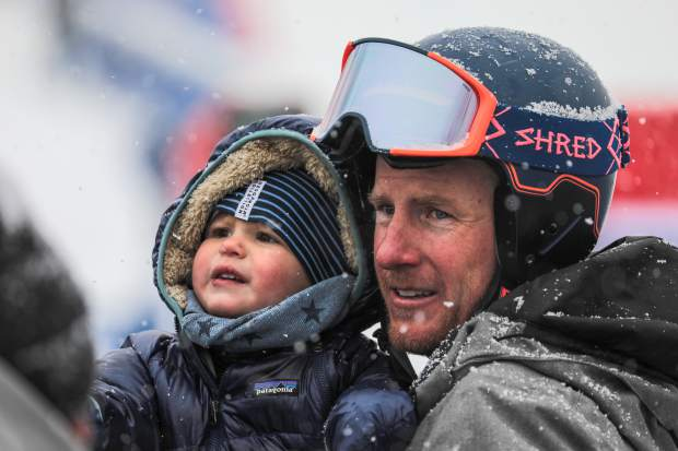 Ted Ligety and his son, Jax, share a moment after the Xfinity Birds of Prey Audi FIS Ski World Cup super-G race on Saturday, Dec. 1, at Beaver Creek. Ligety took 22nd place and will race again in Sunday's giant slalom.
