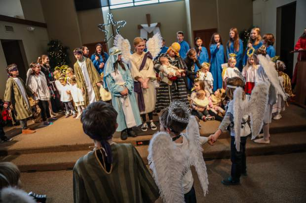 Baby Jesus, played by 6-month-old Bernard Zbrzenznj, of Edwards, is the center of attention during the annual Christmas pageant at Edwards Interfaith Chapel on Monday.