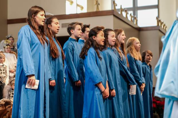 The choir sings celebratory hymns during the annual Christmas pageant on Monday afternoon at Edwards Interfaith Chapel.
