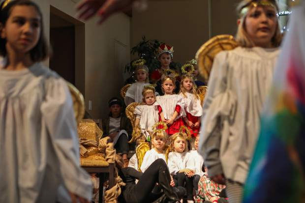 Kids participate in the annual Christmas pageant on Christmas Eve at Edwards Interfaith Chapel. The children practiced for weeks in preparation..
