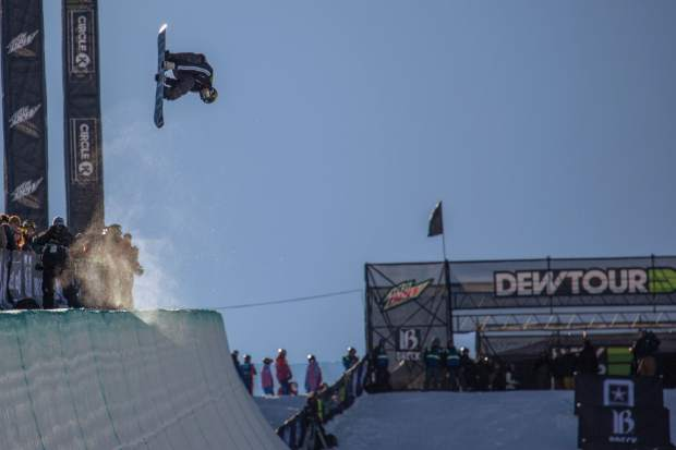 Eagle resident Jake Pates takes flight at the Dew Tour halfpipe snowboarding competition at Breckenridge Ski Resort on Friday, December 15. Pates won the competition and met the minimum objective criteria for qualifying for the Olympics with the result, but two more Olympic qualifying events remain in the season and the competition is stacked.