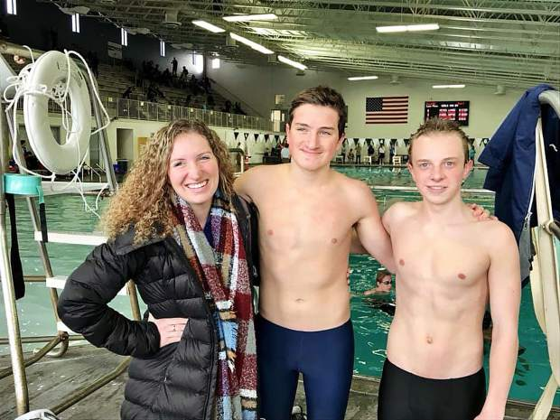 Members of the Avon Swim Team set more personal records in Loveland this past weekend. Their next big meet is Jan. 4-6 in Grand Junction. The Avon Swim Team offers training and practice for swimmers of all ages and ability levels. Call 970-748-4054 for more information. Pictured, from left, is head coach Meghan Hershey, Henry Prince and Charlie Kiddoo.