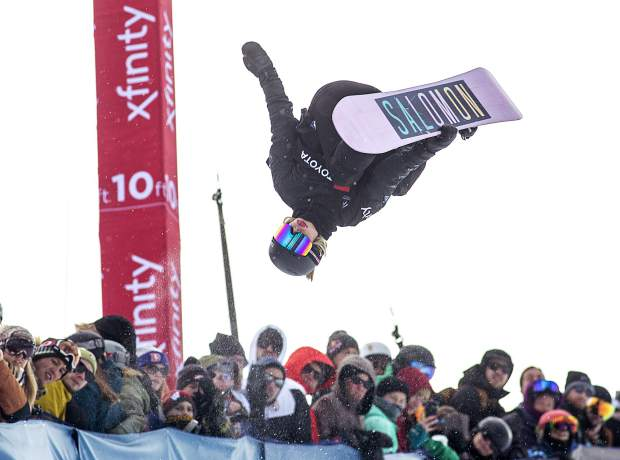 Maddie Mastro, of California, executes a trick in mid-air at the Toyota U.S. Grand Prix World Cup halfpipe snowboard women's finals on Saturday, Dec. 8, at Copper Mountain Resort.