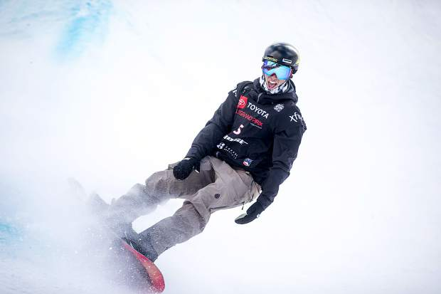 Chase Josey of Idaho lets out a celebratory yell after concluding his halfpipe run at the Toyota U.S. Grand Prix World Cup halfpipe snowboard men's finals on Saturday, Dec. 8, at Copper Mountain Resort.