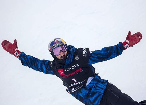 Scotty James, of Australia, reacts after getting the highest score of the day on his last run at the Toyota U.S. Grand Prix World Cup halfpipe snowboard men's finals on Saturday, Dec. 8, at Copper Mountain Resort. James placed first with a high of 96.75.