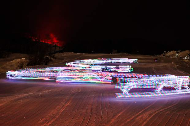 The Devo Ski School kids ski down with lights during the New Year's Eve celebration Monday, Dec. 31, in Vail. Fireworks concluded the festivities.