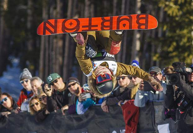 Chloe Kim executes a trick in midair during Dew Tour's snowboard modified superpipe competition on Sunday, Dec. 16, at Breckenridge Ski Resort. Kim won the competition.