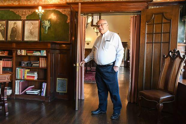 Redstone Castle owner Steve Carver walks through the doorway into the library of the recently restored castle during a media tour on Thursday morning.