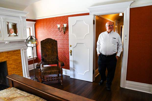 Redstone Castle owner Steve Carver walks through the doorway of Mr.Osgoods room of the recently restore castle during a media tour on Thursday morning.