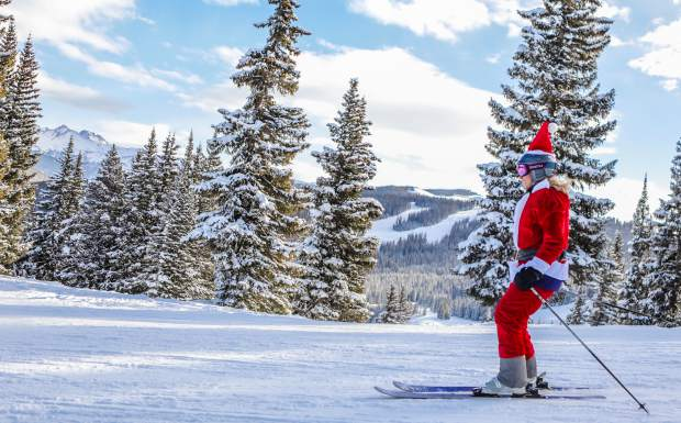 Diane Merriam, as Santa, shreds Vail Mountain after presents on Christmas Day. What started as one costume last year blossomed into a full Merriam family affair this year.