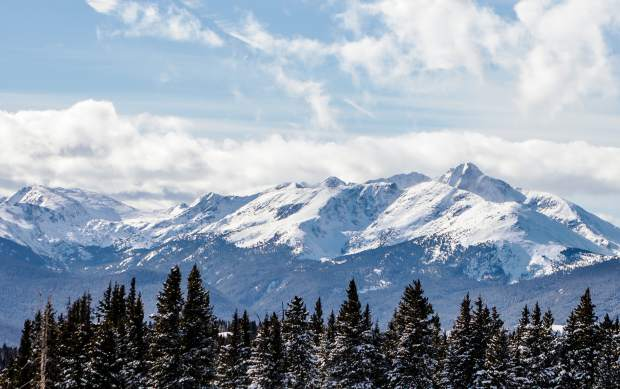 Mount of the Holy Cross peaks out of the clouds Christmas Day in Eagle County. The day gave way to blue skies after a snowstorm on Christmas Eve.