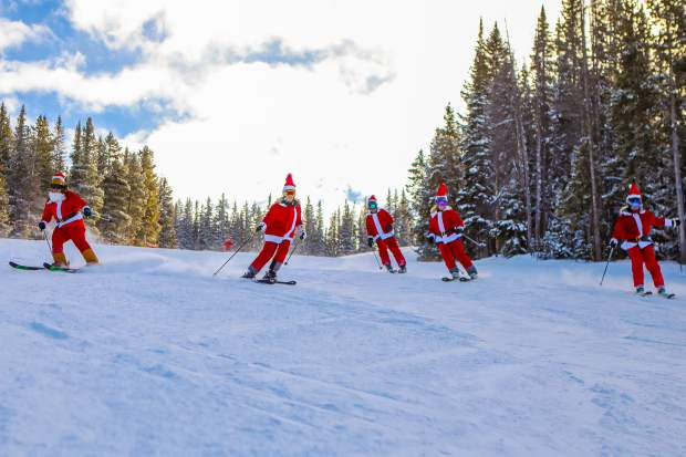 A clause of Santas ski down Christmas run during Christmas Day at Vail Mountain. The Merriam family came from all around the country to gather in Vail for the holidays. The run can be accessed via Chair 4.