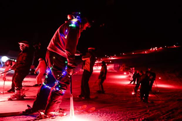 Kevin Grooman, of Avon, dressed in holiday lights, puts out his torches after the ski down on Thursday, the opening night of Snow Days, in Vail. This year's event happens over four days and includes pub crawls and more.
