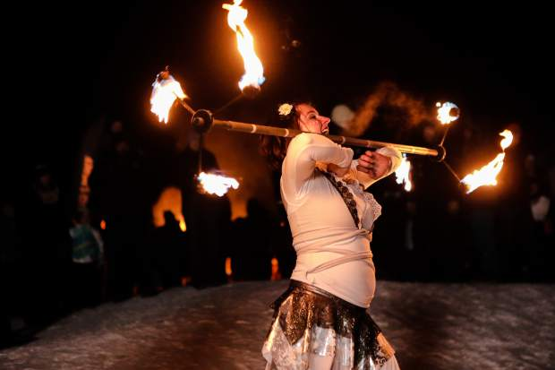 Fire dancer Dani Kinard entertains the crowd gathered for Snow Days fun in Vail. Vail Snow Days continue through Sunday.