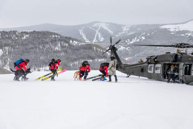 Vail ski patrol approaches a High-Altitude Aviation Training Site Blackhwack helicopter during training for avalanche rescue training Wednesday, Jan. 23, in Vail. A joint training between Beaver Creek and Vail Ski Patrol highlights the importance of snow safety, even inbounds.