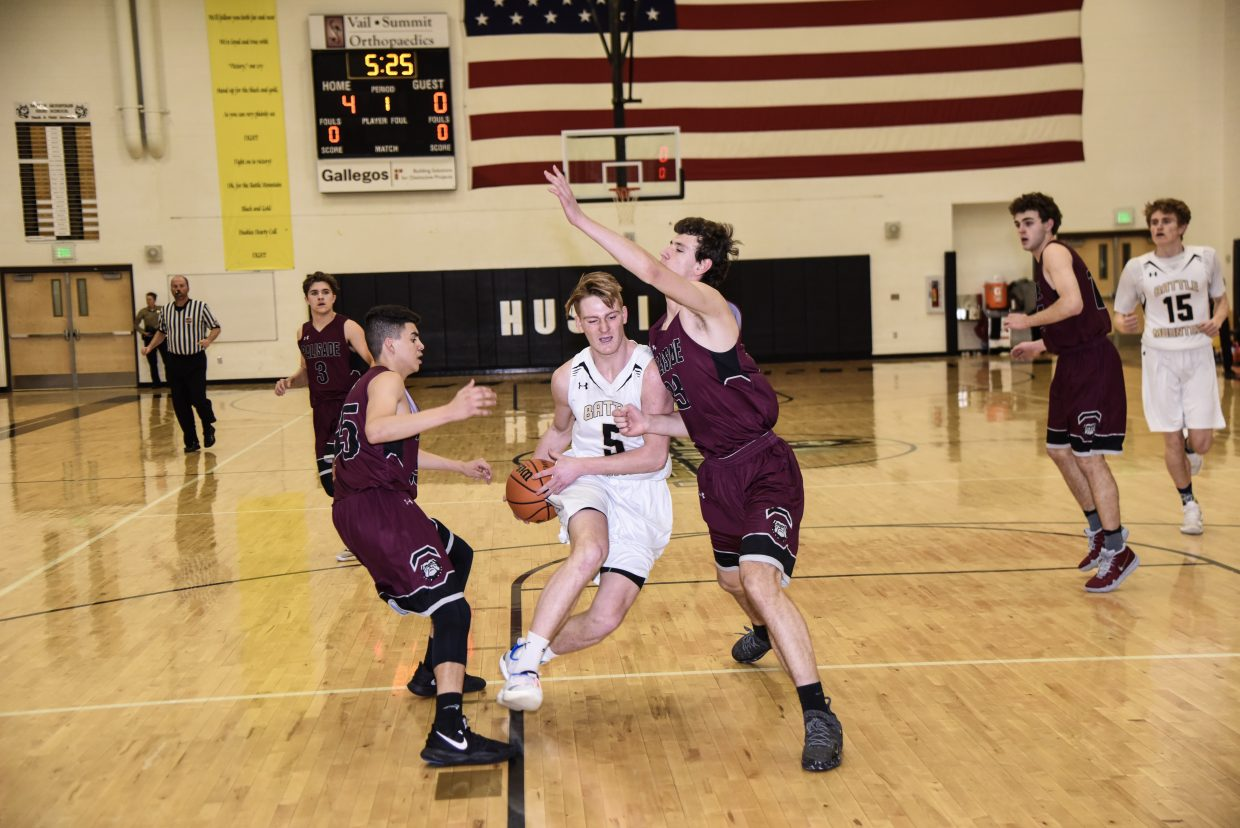 Liam McKenny charges toward the basket against Palisade on Tuesday. While McKenny had 11 points, the Huskies dropped a 65-56 decision to the Bulldogs.