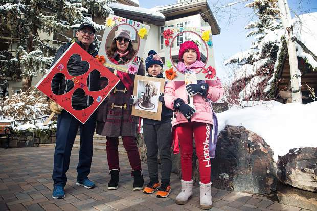 A local Vail family stands in solidarity with other women protesters at the Covered Bridge in Vail on Saturday.