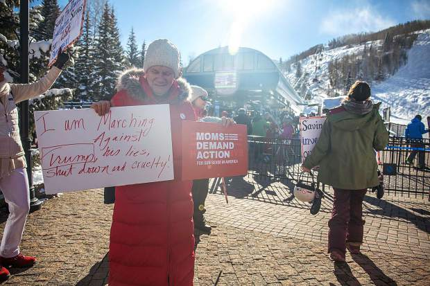 Thirty women and a handful of men, young and old, took to the streets of Vail on Saturday in protest of today's political climate.