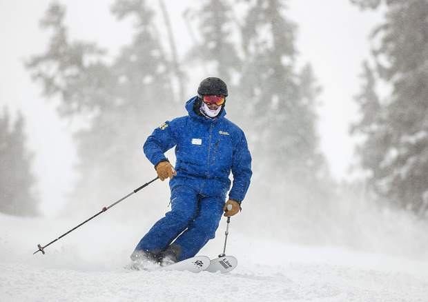 Copper Mountain Resort's new general manager and former NFL player Dustin Lyman skis front-side terrain on Friday, Jan. 25, at the resort.