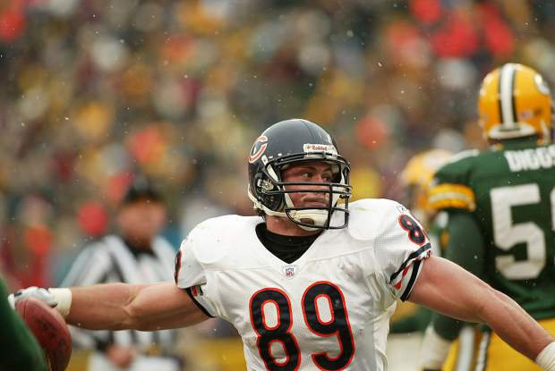 Dustin Lyman spikes the football to celebrate a touchdown for the Chicago Bears of the National Football League during a December 2002 football game against the Green Bay Packers at Lambeau Field.