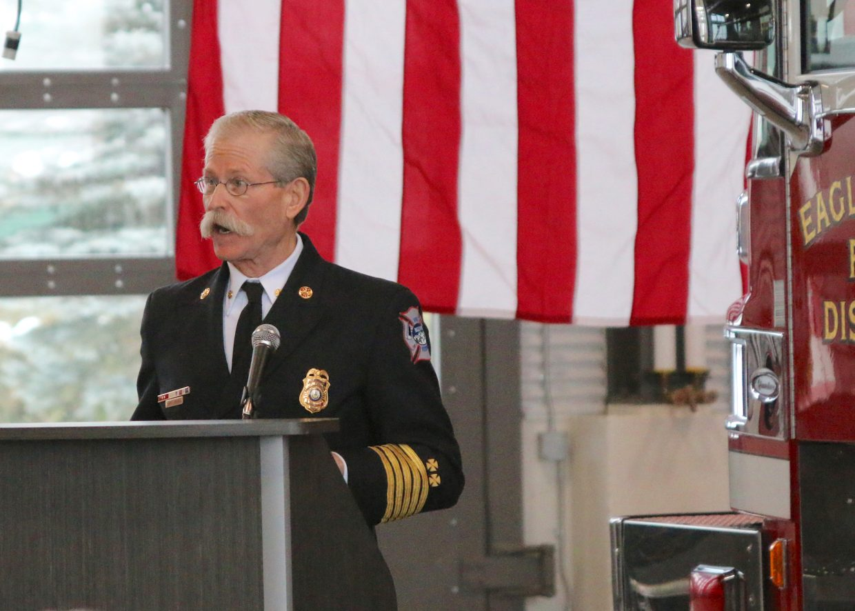 Eagle River Fire Protection District Fire Chief Karl Bauer welcomes the crowd to dedicate their new Station 12.
