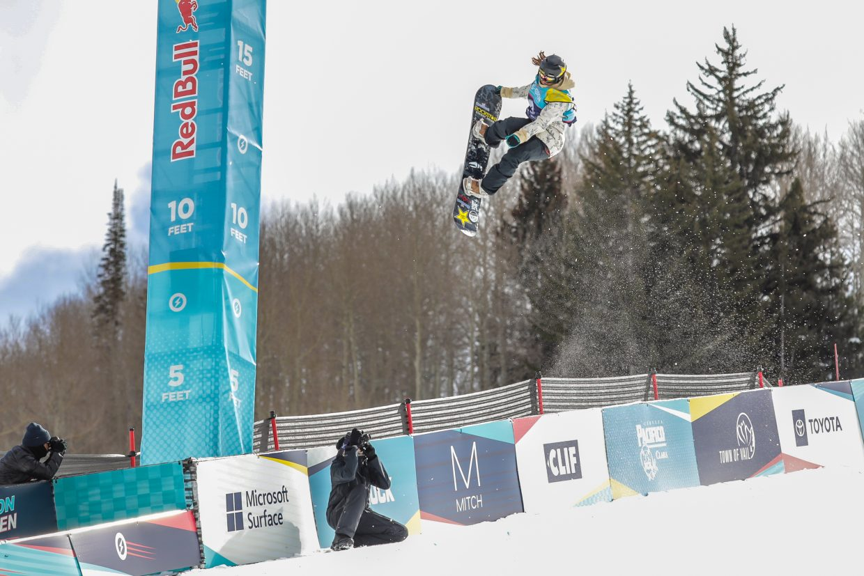 Arielle Gold of Steamboat Springs tail grabs on her first hit of her second run for the Women's Halfpipe Semi-Finals for the Burton US Open Snowboarding Championships Thursday, Feb. 28, in Vail. Gold qualified second.