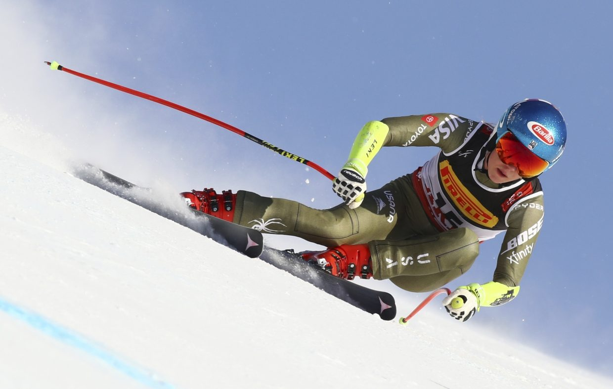 Mikaela Shiffrin races to a win in the women's super-G at worlds. She edged out Italy's Sofia Goggia by 2-hundredths of a second.