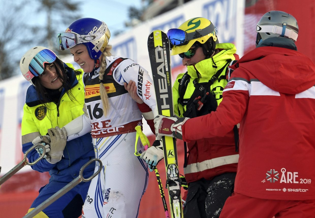Lindsey Vonn is assisted after crashing during the women's super-G at the FIS Alpine World Ski Championships. Vonn was able to ski down the hill under her own power.