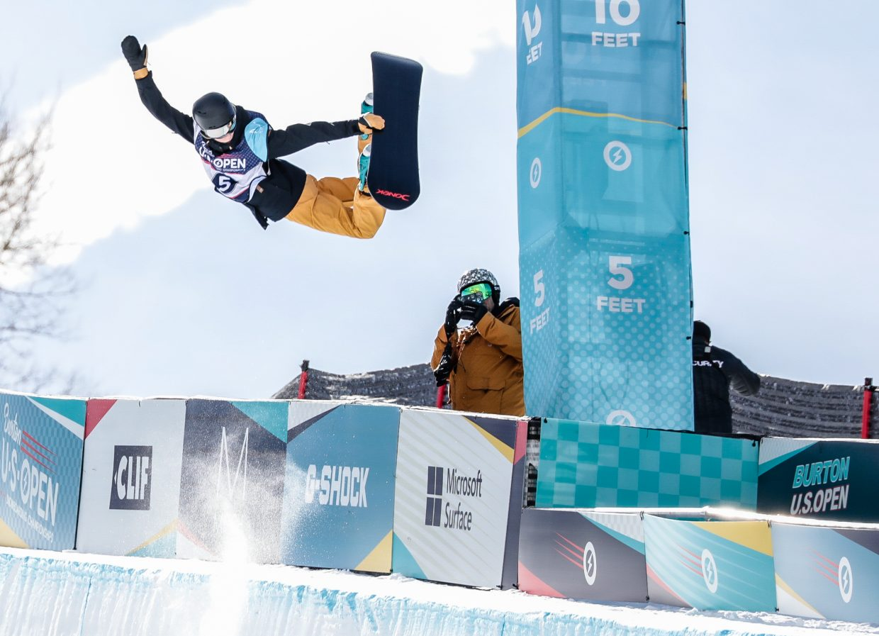 Brooke D'Hondt, 13-years-old, of Canada does a method grab on the first hit of her first run for the Junior Jam during the Burton US Open Snowboarding Championships Tuesday, Feb. 26, in Vail. D'Hondt finished with a score of 82.74.