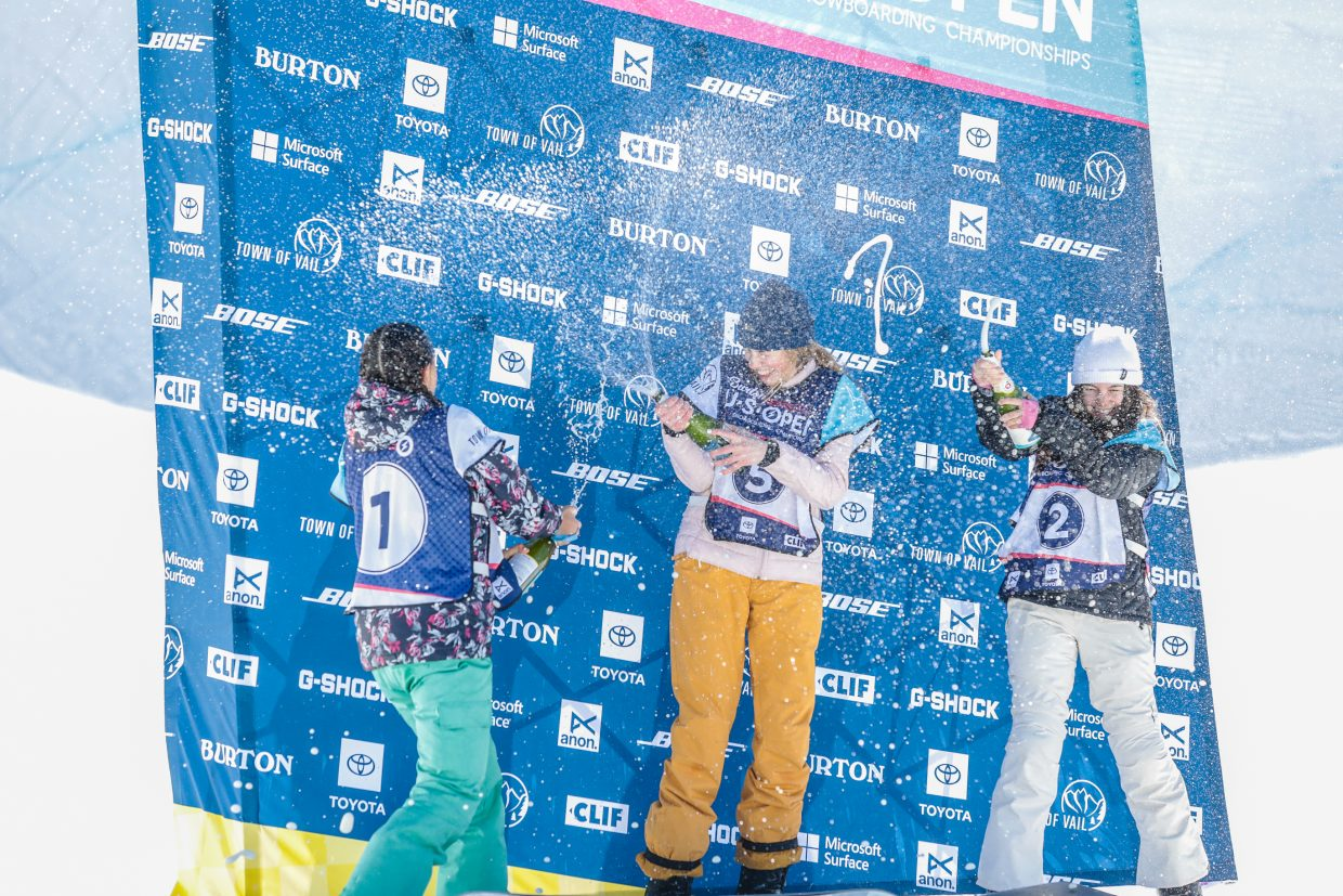 The top three girls celebrate the podium with sparkling juice after the Burton US Open Junior Jam Tuesday, Feb. 26, in Vail.