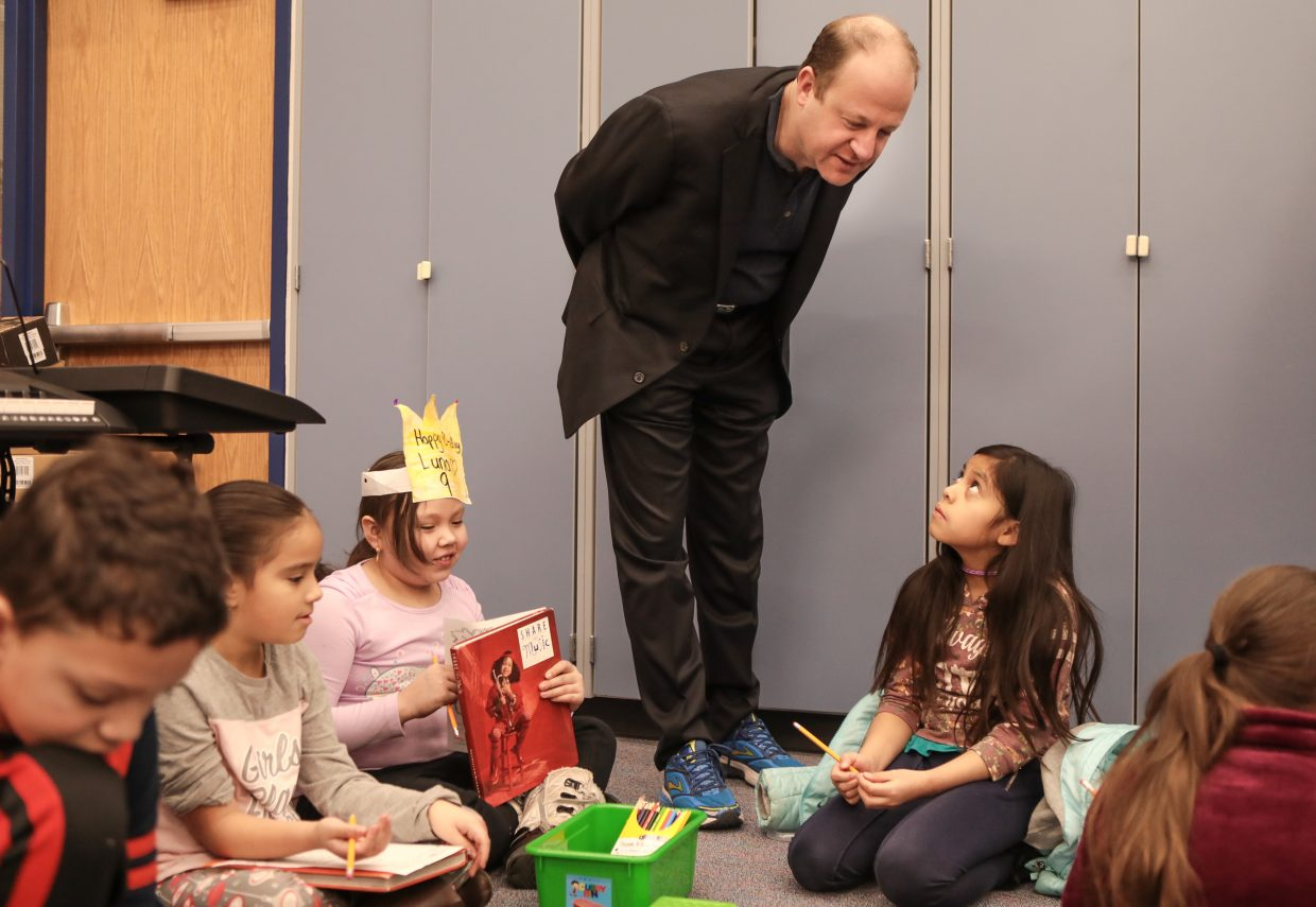 Colorado Gov. Jared Polis talks to Avon Elementary School kindergarteners during a visit.