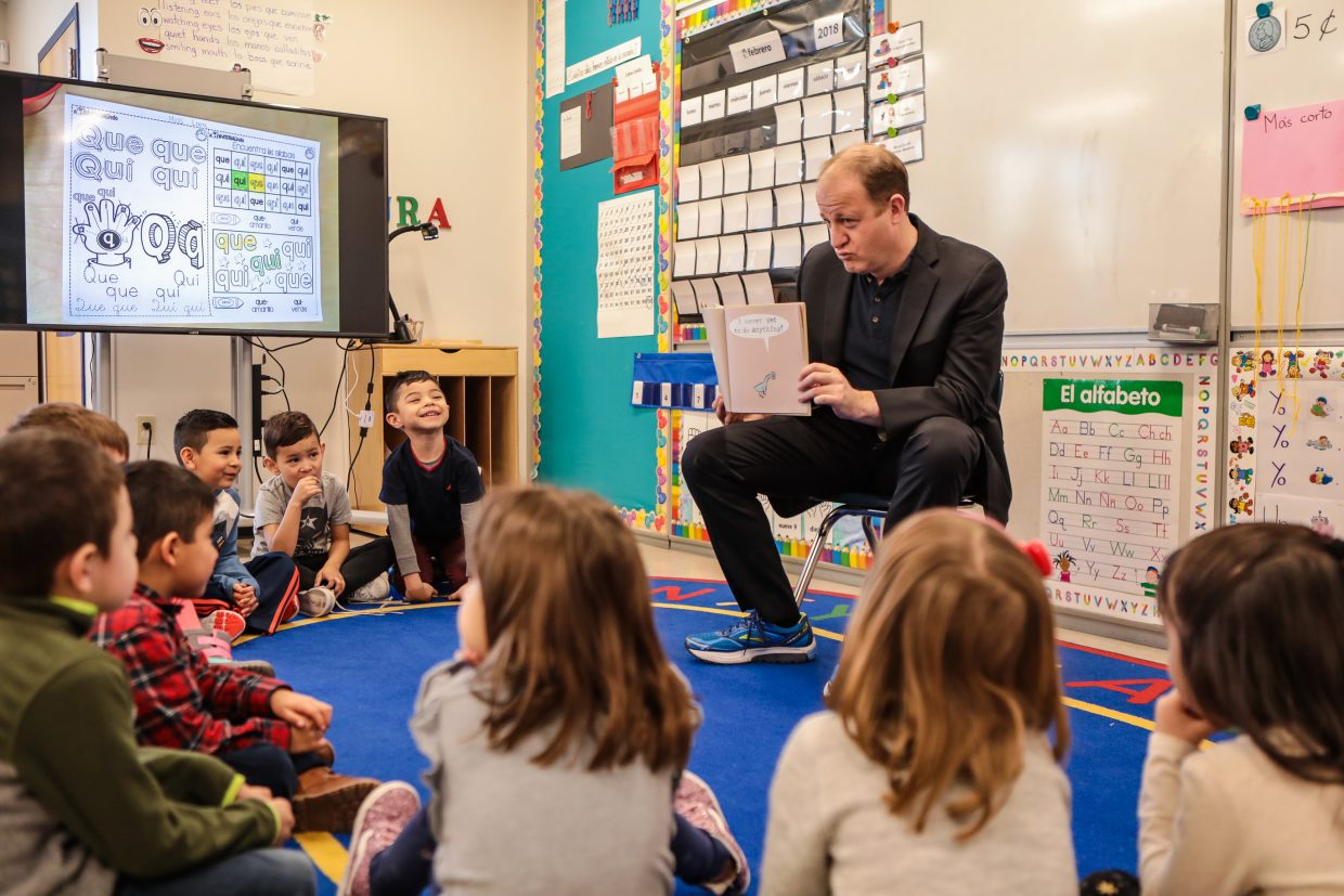 Colorado Gov. Jared Polis reads a book to Avon Elementary School kindergarteners during his school visit Friday, Feb. 1, in Avon. The book was about wanting to drive a bus but being too young.