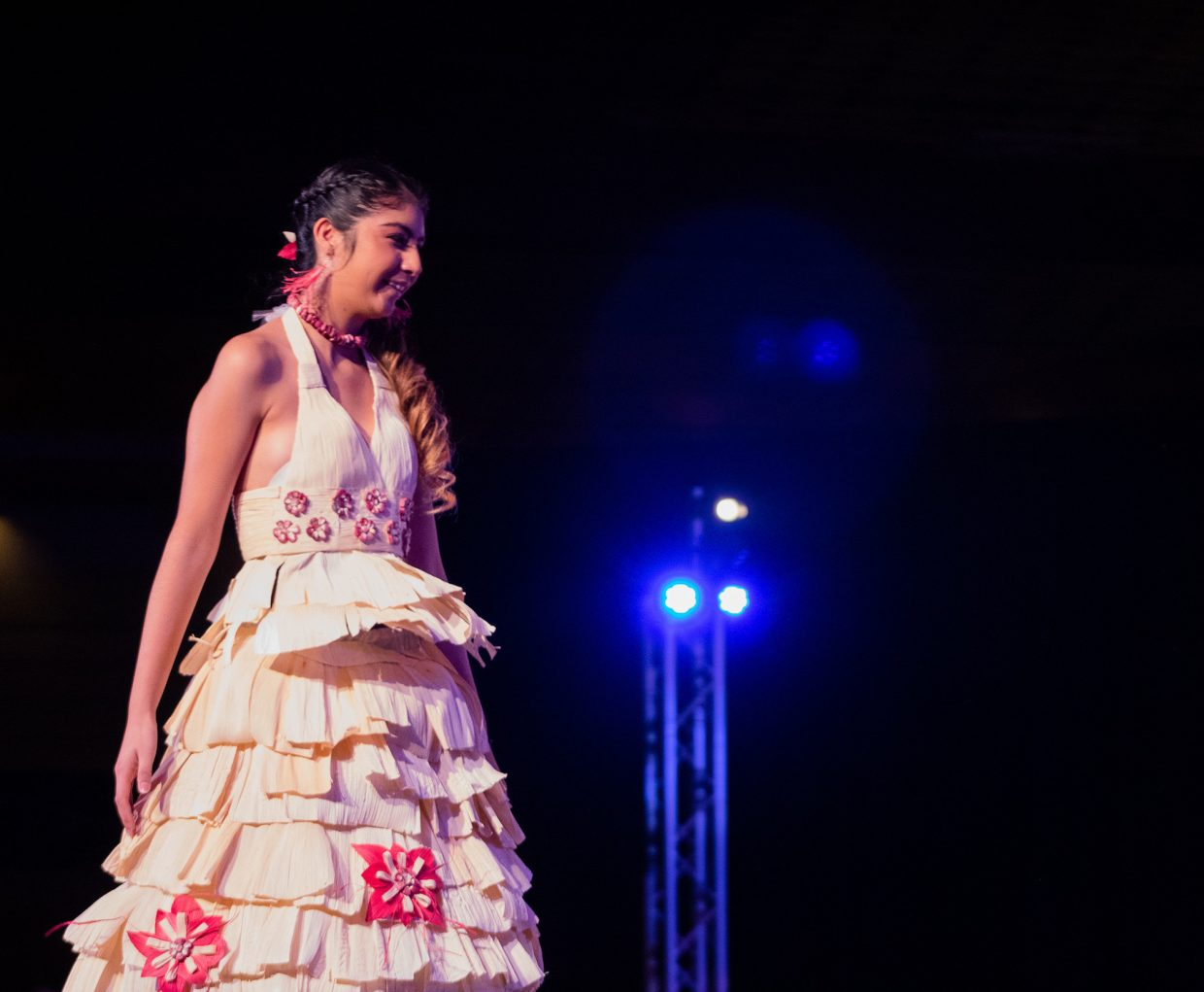 The dress that won the young adult division was designed and modeled by Adriana Avila to reflect her Mexican heritage.