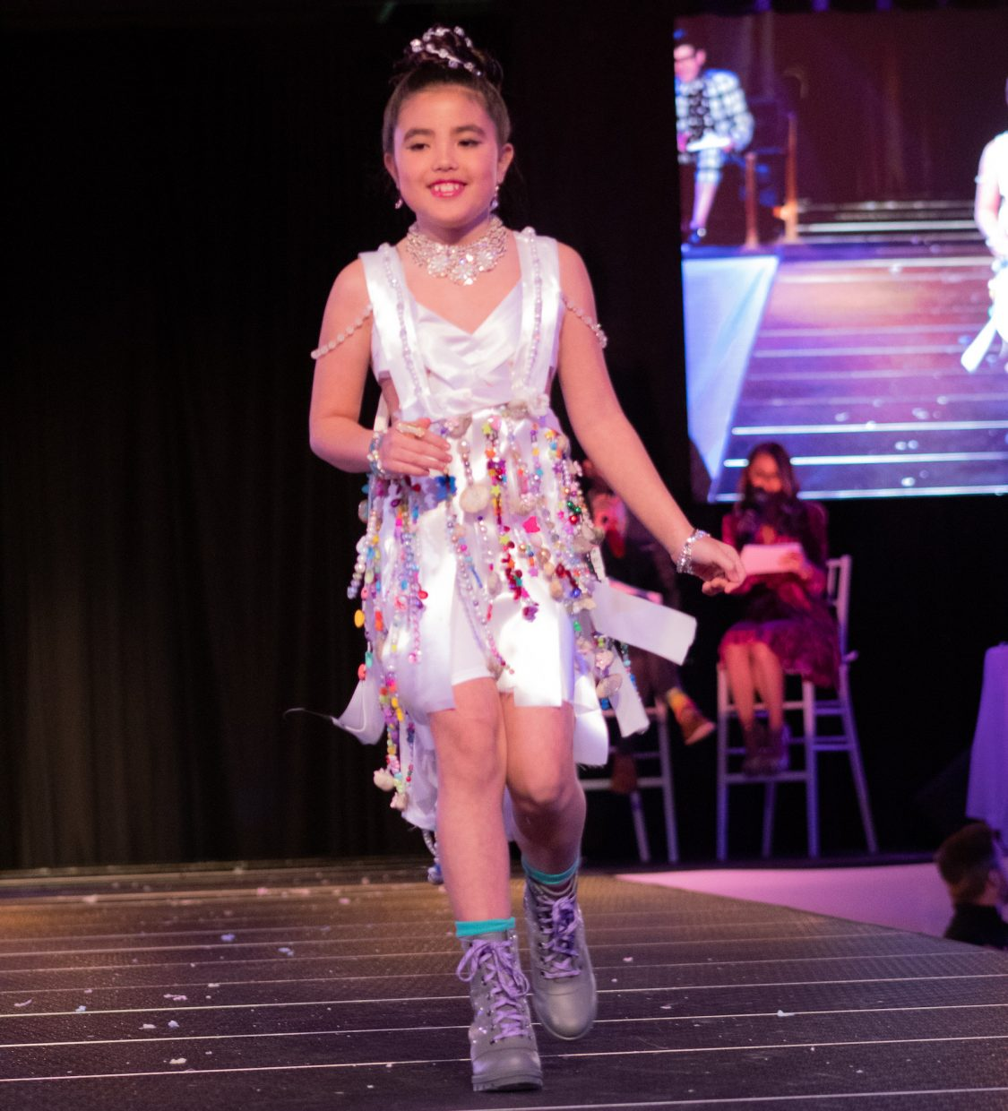 Brielle Dale, the reigning champ of the youth division, took home the title again this year, sporting a dress decked out with beads and jewelry.