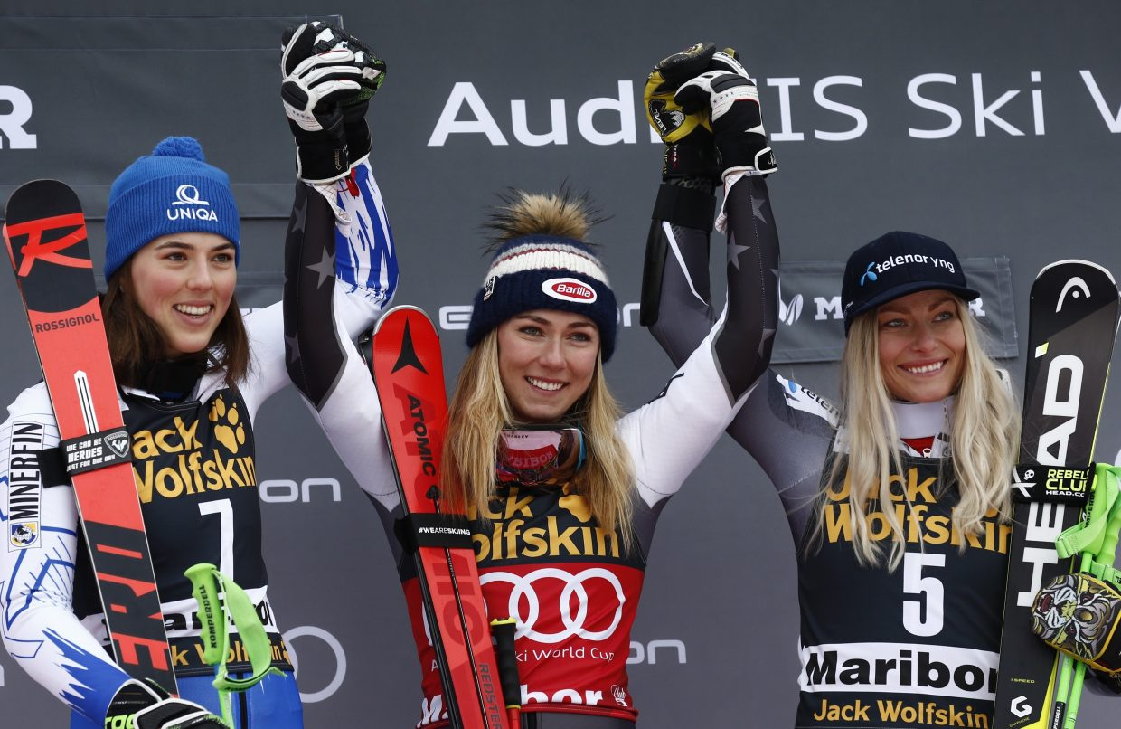 Mikaela Shiffrin and Slovakia's Petra Vlhova, left, both winners in Friday's women's World Cup giant slalom, celebrate with third place finisher Ragnhild Mowinckel of Norway.