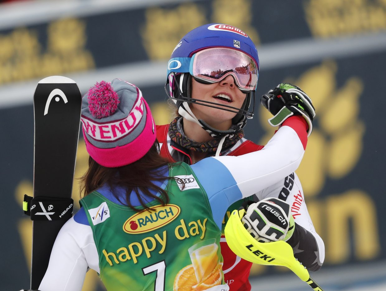 Switzerland's Wendy Holdener, left,  congratulates Mikaela Shiffrin after Saturday's World Cup slalom in Maribor, Slovenia. Shiffrin won the race, while Holdener was third.