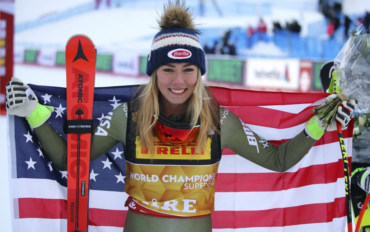 United States' Mikaela Shiffrin holds up the flaf as she celebrates winning the women's super-G, at the FIS Alpine World Ski Championships in Are, Sweden, on Tuesday. It's the fourth worlds gold of her career, and opens the possibility of a multiple gold medals at the event.