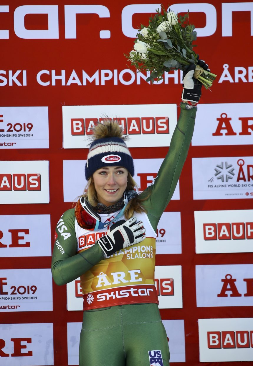 Mikaela Shiffrin celebrates her fourth consecutive FIS Alpine World Ski Championships slalom title on Saturday in Are, Sweden. No one has ever won four straight titles in the same discipline at worlds.