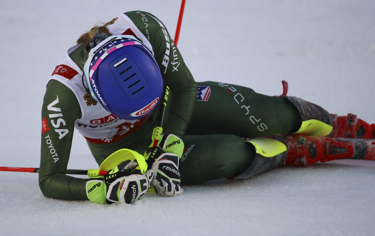 Mikaela Shiffrin goes down to the snow after winning the FIS Alpine World Ski Championships slalom on Saturday in Sweden. The four-time slalom world champion was battling a cold, but still won by more than half a second.