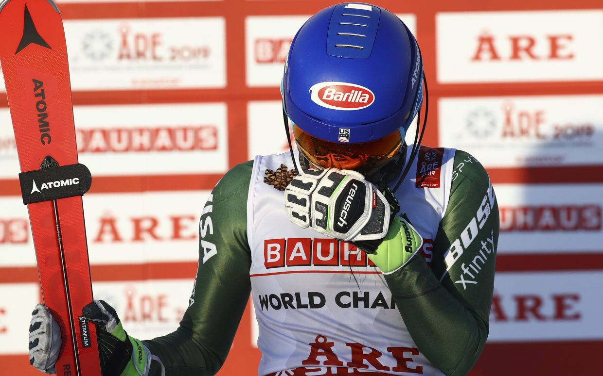 Mikaela Shiffrin takes a moment on the podium in  Are, Sweden. She won the FIS Alpine World Ski Championships on Saturday for her third medal of the event.