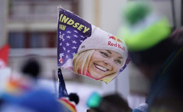 Supporters hold a flag with a portrait of United States' Lindsey Vonn in the finish area prior to the start of the women's downhill race, at the alpine ski World Championships in Are, Sweden, Sunday, Feb. 10, 2019. (AP Photo/Giovanni Auletta)
