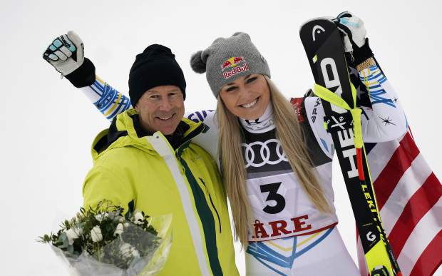 United States' Lindsey Vonn, right, celebrates her third place with Sweden former skier Ingemar Stenmark after the women's downhill race, at the alpine ski World Championships in Are, Sweden, Sunday, Feb. 10, 2019. (AP Photo/Giovanni Auletta)
