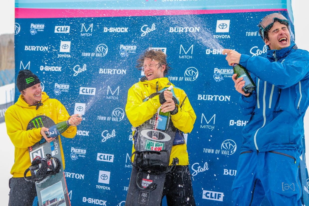 Red Gerard, center, celebrates his first men's slopestyle finals win at the Burton US Open with the rest of the podium, Sven Thorgren (second place) and Mark McMorris (third place).