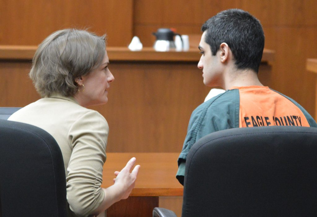 Public defender Thea Reiff confers with her client. Part of Young's sentence demands that he and his family turn over his phone and phone records to investigators.