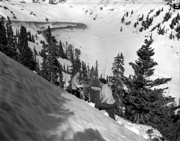 Courtesy Lauren Cooper, Colorado Department of Transportation | Ted Bakken receives a charge from Harold McMillian on the west side of Loveland Pass in the Little Professor slide area in 1954.